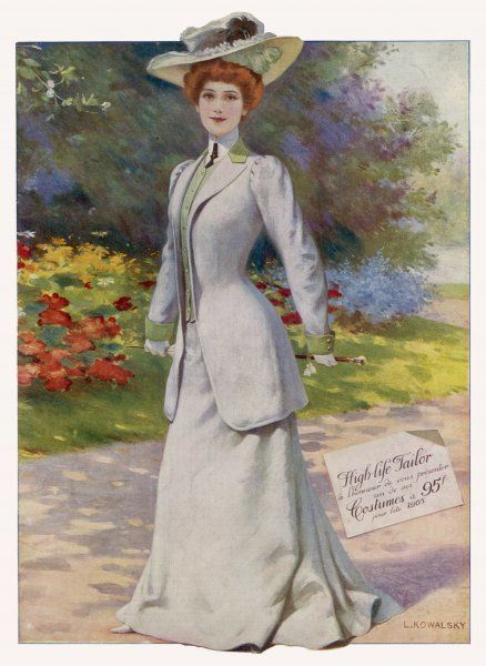 A young woman in a pale grey tailor-made suit -- a long line jacket with green collar and turned back cuffs, green waistcoat, gored bell shaped skirt, high all-round collar with a tie and a picture hat