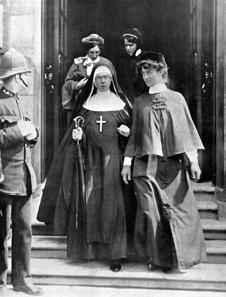 Watched by a policeman, nurses and nuns leave the War Office after receiving their orders following the outbreak of war in August 1914