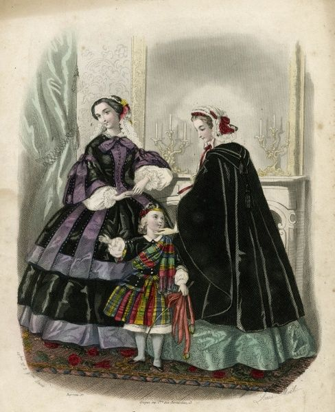 Two women and a child in the latest French fashions. The woman on the left wears a black and purple dress, while the woman on the right wears a green dress with a black velvet cloak. The little boy wears a tartan riding outfit, including a matching cap