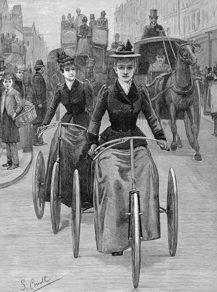 Engraving showing two women cyclists on their tricycles, pedalling along a busy road