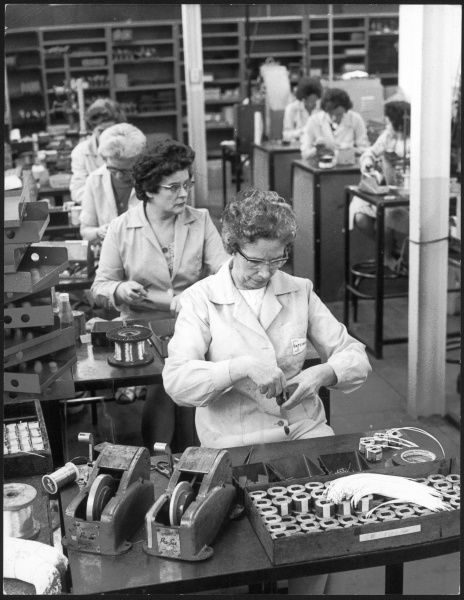 Women working on a switch gear assembly line in slough