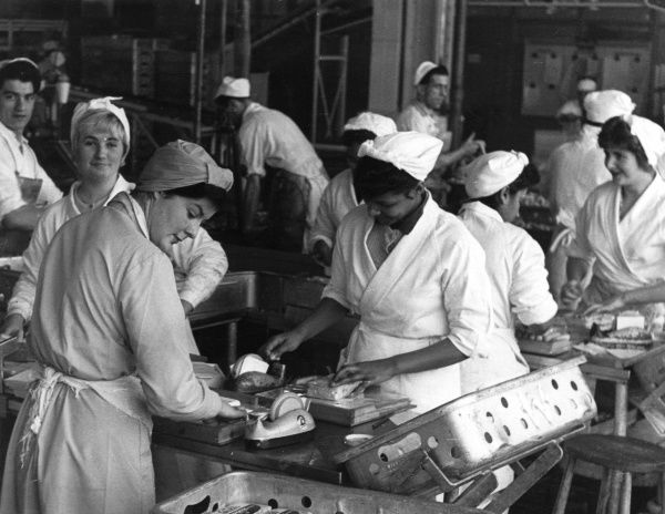 Women working in a packaging department. Date: 1959