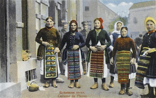 Pleven, Bulgaria - Women in the costume of the region, incorporating patterned ornamental aprons