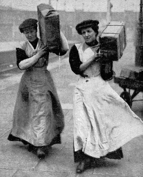 Photograph showing two women railway porters in 1915. As World War I progressed, women began to work in traditionally male jobs as part of the war effort. This development was instrumental in women gaining the vote shortly after the end of the war