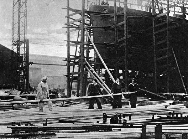 Women workers handling long steel bars in a naval ship-building yard in 1916. World War I saw women taking on traditionally male jobs for the first time, and was a factor which led to women winning the right to vote shortly after the end of the war