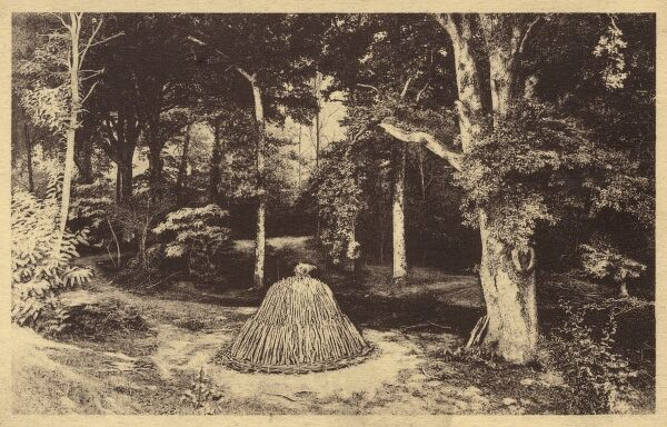 A wood stack assembled prior to burning to create charcoal. The carefully layered stack was covered in sods and burned very slowly. Traditional areas where this practise was undertaken in England were the Forest of Dean and the New Forest. Date