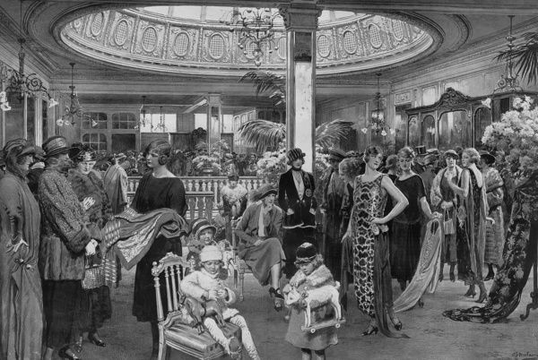 The Christmas Shopping Season - A Sphere artist visits a West-End House. A scene in the costume salon of Messrs. Woolland's well-known house in Knightsbridge, 'the centre of fashion.' A busy scene captured by the Sphere's special artist, Fortunino Matania
