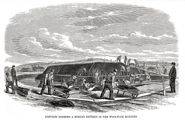 The Woolwich 'hulks' (prison ships) - convicts forming a mortar battery. Date: 1862