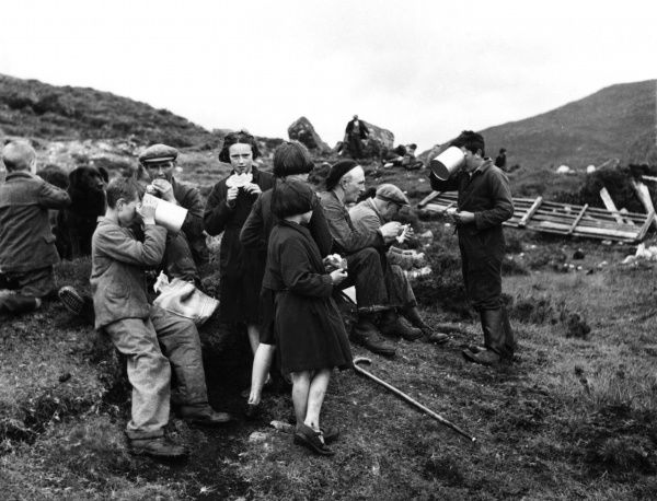 Production of Harris Tweed. A party of workers take a break for lunch. Date: circa 1940