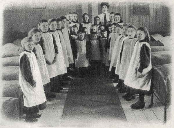The girls' dormitory at an unidentified workhouse. Date: 1909