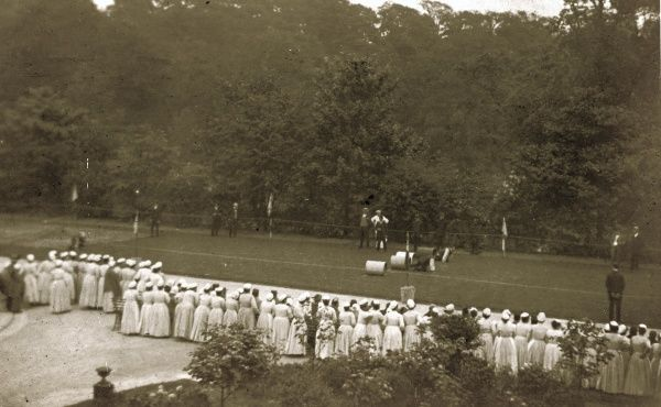 Inmates of the Sheffield Union workhouse at Fir Vale watch as male competitors take part in an obstacle course during a sports day