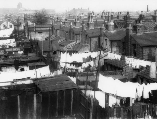 Back-to-back housing showing the cramped back yards and dazzling white washing on the line