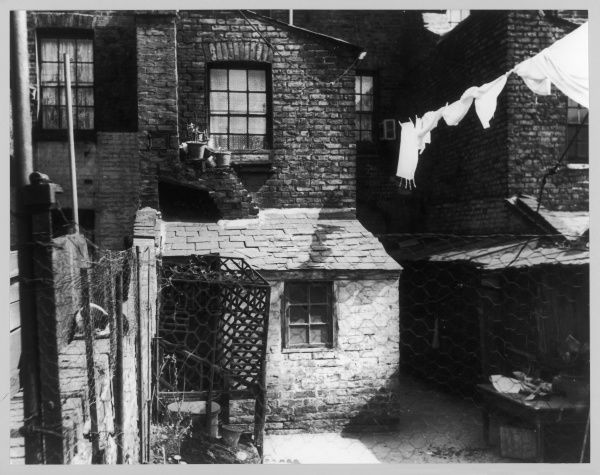 Working class Victorian slum houses, with sash windows and slate roofs in poor repair, London. Date: 1930s