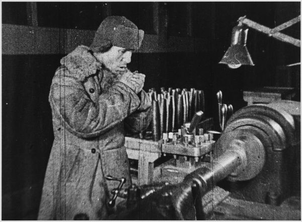 Munitions worker in outdoor factory