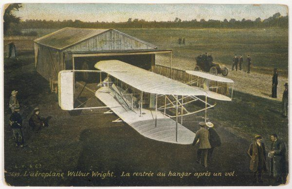 Wilbur Wright's biplane is returned to its hangar at Auvours, after one of the many training and demonstration flights he made here