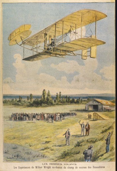 Wilbur Wright demonstrates his flying machine over the racecourse at Hunaudieres, near Le Mans, France : on one such flight he remains in the air for 7 minutes !