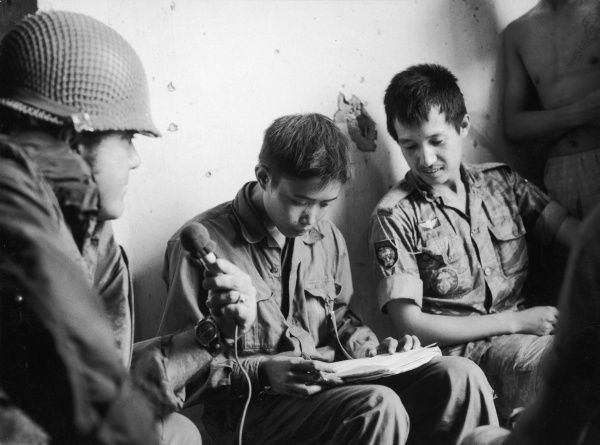 A young, captured North Vietnamese soldier is allowed to write a letter home