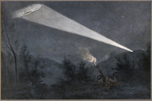 A German Zeppelin airship is picked out in the night sky by a searchlight from a fort on the French border. A French artillery position opens fire