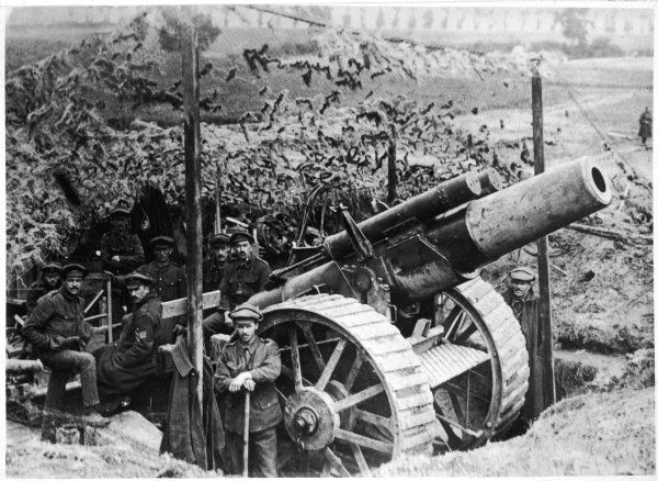 A British gun emplacement on the Western Front: a Howitzer camouflaged under netting