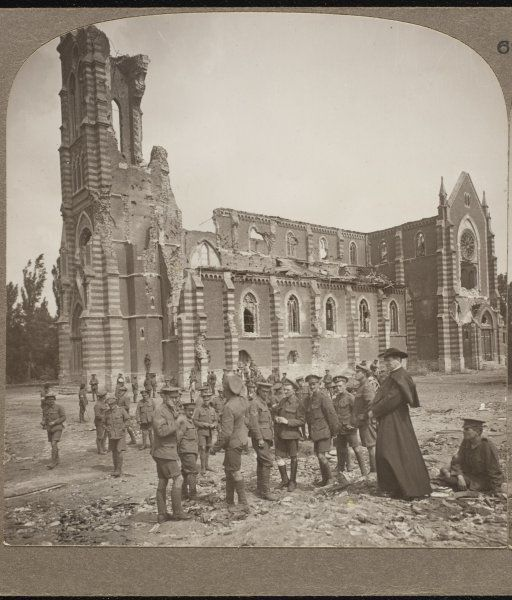 A French cure tells British infantrymen how his church was destroyed by German shelling