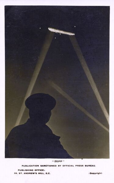 """Zepp!"" WW1 - Zeppelin over the UK illuminated by searchlights Date: circa 1917"