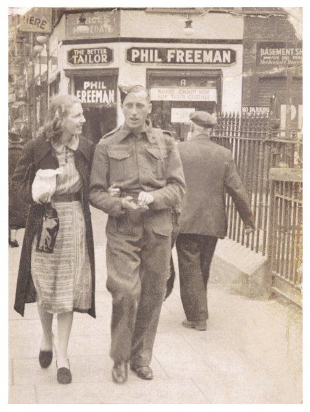 A British soldier on leave, arm in arm with his sweetheart
