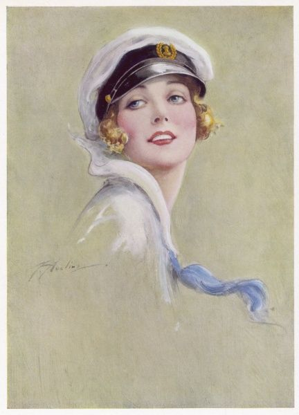 A sporty young yachting girl in a sailers cap