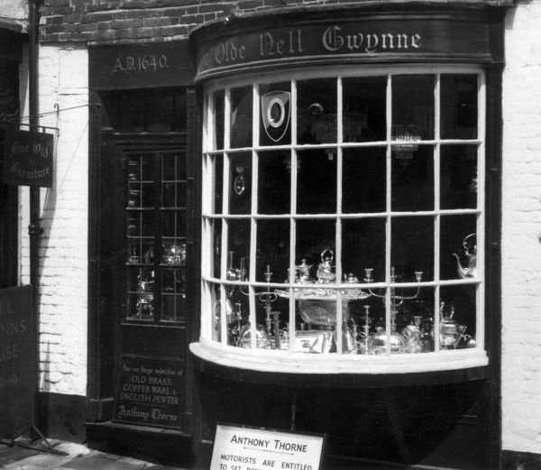 'Ye Olde Nell Gwynne', now an antique shop in Windsor, Berkshire, England. Nell Gwyn would stay here while Charles II was at Windsor Castle. Their two sons were born here. Date: 1650 - 1687