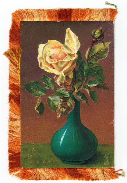 yellow rose in a vase on a new year card with a fringed edge date