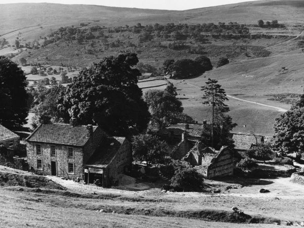 Typical cottages, including the ruins of a barn, in the Dale of Yockenthwaite, near Hubberholme, Yorkshire