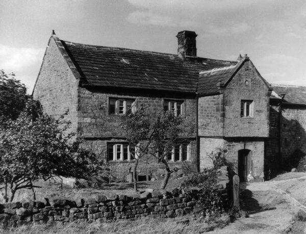A typical sturdy stone-built farmhouse at Low Snowdon, near Otley, Yorkshire, England. Date: 18th or 19th century