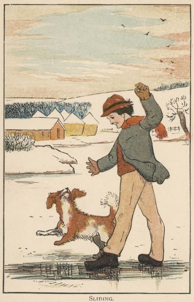A young boy slides on the ice, his dog trotting happily alongside