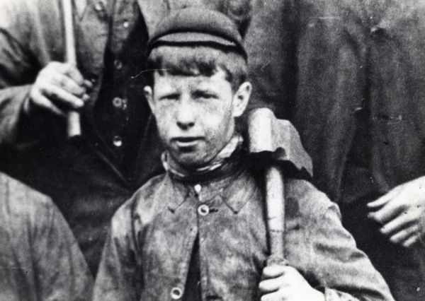 A young collier, about 14 years old, at a colliery in the Saundersfoot area of Pembrokeshire, Dyfed, South Wales. The mines employed children as young as ten