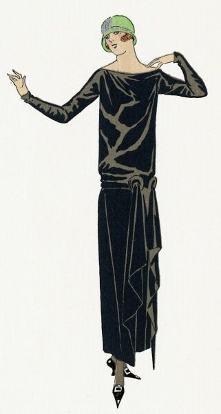 Young lady wearing a black long-sleeved, figureless dress, with a long belt tied at the hips, by Drecoll.  1924