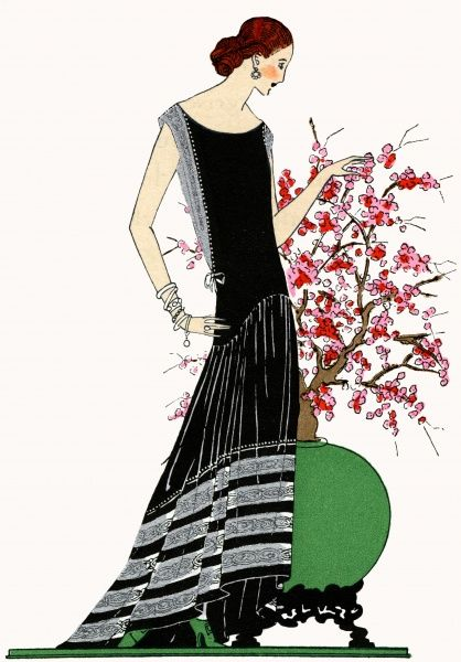 Young lady wearing Turkish style black evening dress trimmed with silver lace and pearls, by Jeanne Lanvin. 1924