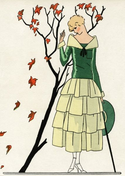 Young lady in a two-tone green dress by Paul Poiret, with autumn leaves falling from a tree.  1924