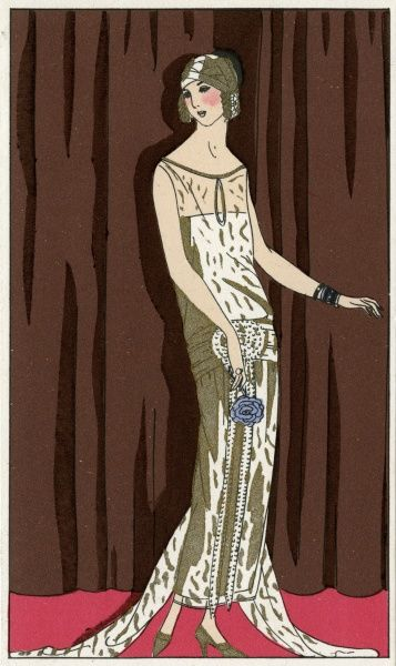 Young lady wearing a sleeveless gold sheer lace evening dress worn over a white slip, with a pearl and emerald belt, by Jeanne Lanvin.  1924