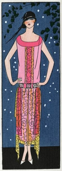 Young lady in a salmon pink crepe evening dress with lace trimmings, by Beer.  1924