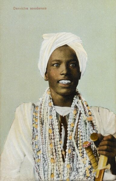 A Young Sudanese Dervish, holding a dagger and grinning widely