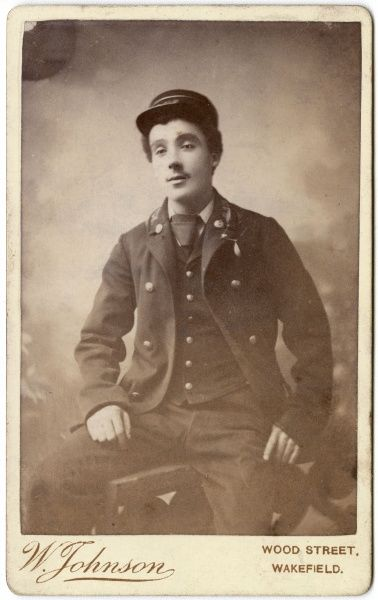 A young Victorian railwayman poses in his uniform