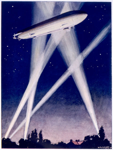A Zeppelin raider is caught in the searchlights over the countryside