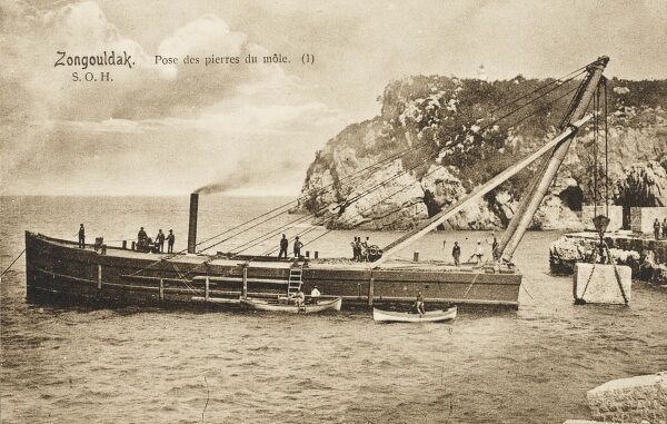 A crane boat lifts a large stone (or concrete block) to build a new jetty at Zonguldak (formerly Heraclea), a city and the capital of Zonguldak Province in the Black Sea region of Turkey