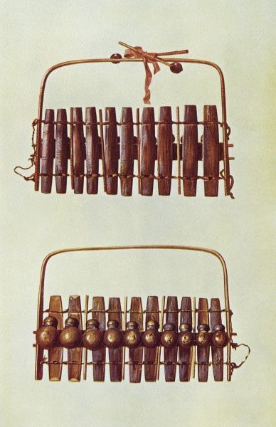 The MARIMBA of the Zulu peoples of South Africa, seen from front and back : it is played with drumsticks. Similar instruments are used in Java, Costa Rica etc. Date: early 20th century