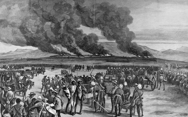 British army massed with infantry and several gun carriages, burning in the background in the Zulu capital Ulundi, where the British made their final defeat of the Zulus on 4th July 1879