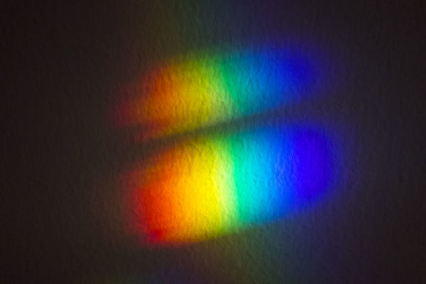 Light refraction on the wall. Spectrum of colours