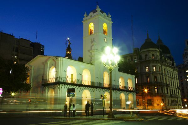 Argentina, Buenos Aires Province, Buenos Aires. Dusk scene of the Cabildo in the Plaza De Mayo in Buenos Aires
