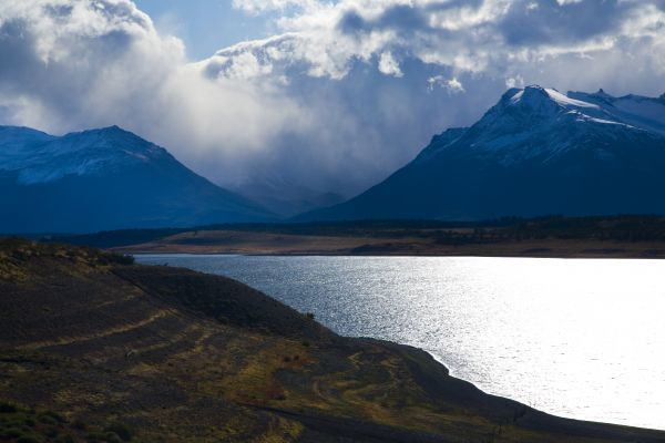 Argentina, Patagonia, Los Glaciares National Park. Storm clouds clear from above the Patagonian Mountains surrounding Brazo Rico in Lake Argentino