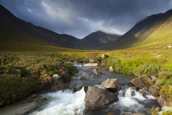 Scotland, North Ayrshire, Isle of Arran. Glen Sannox, a remote valley surrounded by mountains on the Island of Arran