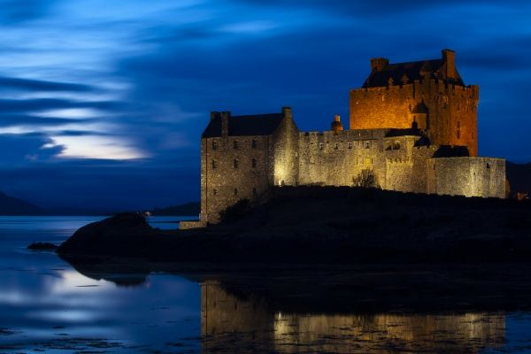Scotland, Scottish Highlands, Eilean Donan Castle. Eilean Donan Castle reflected in the still waters of Loch Duich at dusk