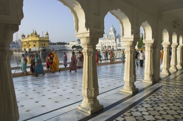 Group of Sikh women pilgrims walking around holy pool, Golden Temple, Amritsar, Punjab state, India, Asia